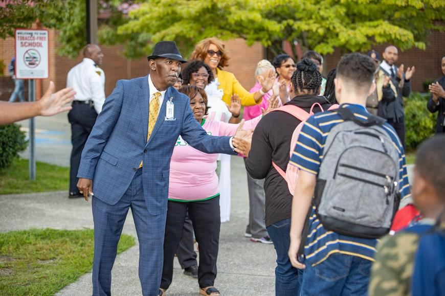 Superintendent and community partners greet students on the first day of school