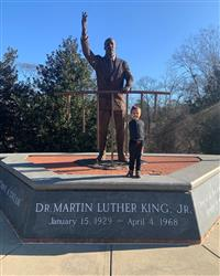 Child in front of Statue of MLK