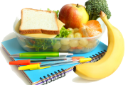 Image of notebooks, pencils, a sandwich, and some fruit.