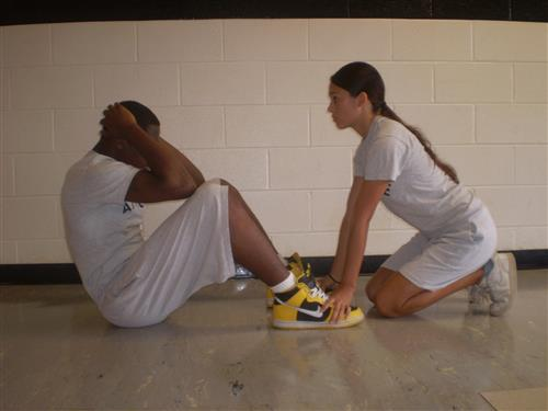 Image of a male and female cadets demonstrating how to do sit ups- second position