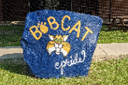 Image of large rock painted with a bobcat face and says Bobcat Pride