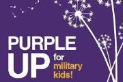 Image of a purple sign with the caption purple up for military kids