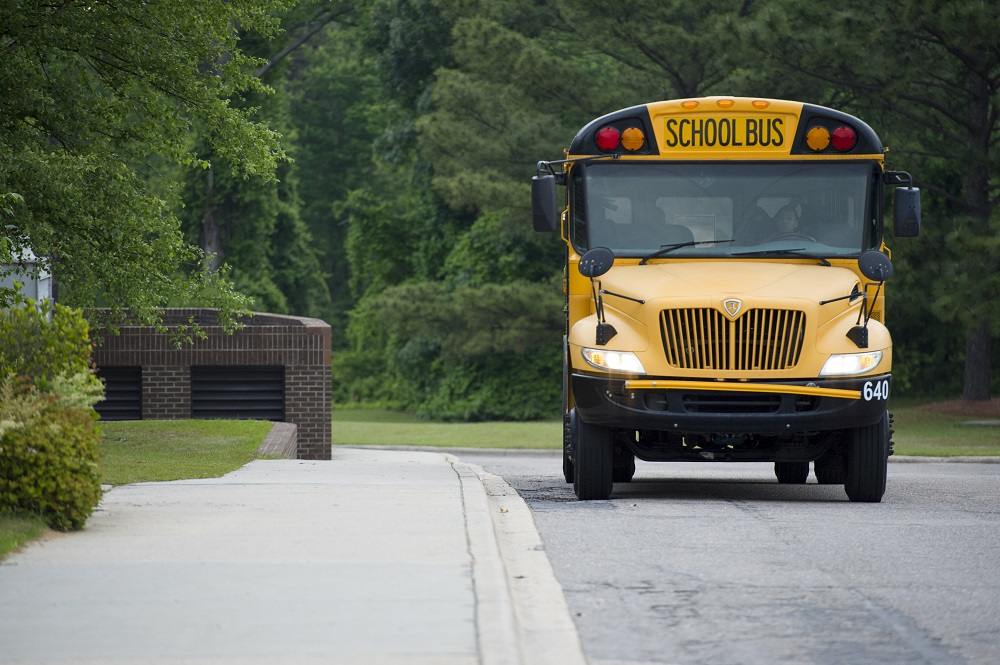 image of yellow school bus on roadway